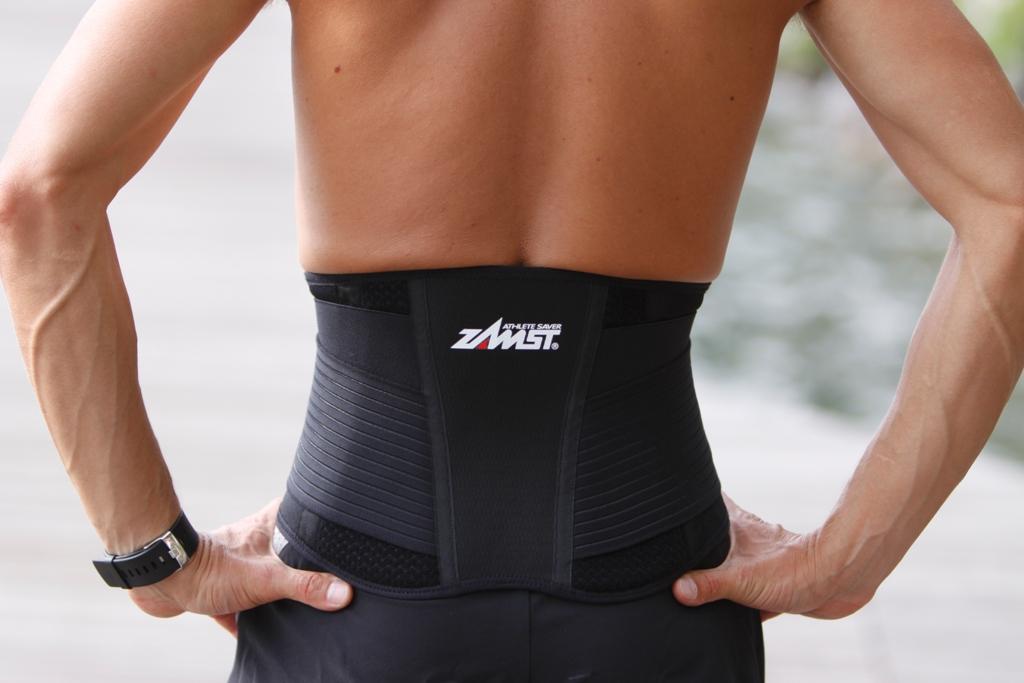 Почему болит спина после тренировок?